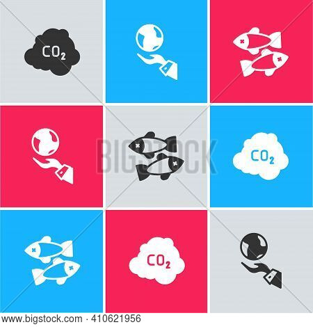Set Co2 Emissions In Cloud, Hands Holding Earth Globe And Dead Fish Icon. Vector