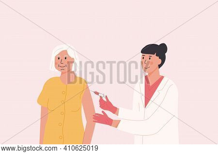 Female Doctor In Medical Gown And Gloves Gives Vaccine Shot To Elderly Patient. Vaccination Campaign
