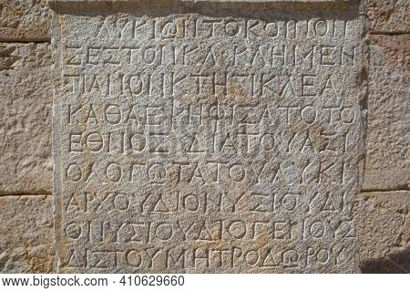Ancient greek writing on stone in ancient city of Patara, Turkey