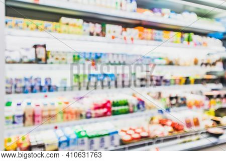Blurred Variety Of Drinking Yogurt, Soy Milk,low Fat Milk And Healthy Drink On Freezer Shelves At Co