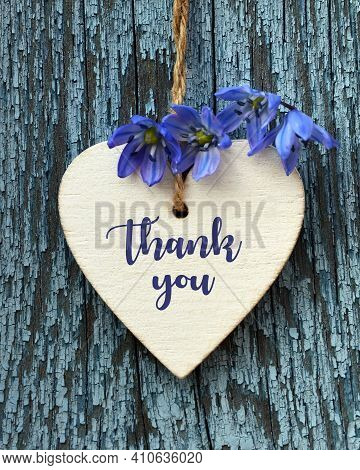 Thank You Or Thanks Greeting Card With Spring Flowers And Decorative White Heart On A Blue Wooden Ba