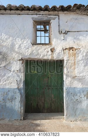 Door Of A Rustic House, In A Village Of Andalusia In Southern Spain