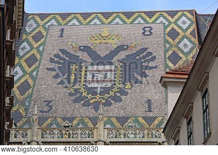 Vienna, Austria - July 12, 2015: Big Coat Of Arms At St. Stephen Cathedral Roof In Wien.