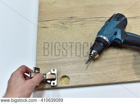 Cordless Combi Drill For Assembly The Furniture Door Hinges Ot He Wooden Furniture Made Of Particle