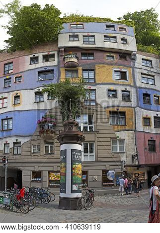 Vienna, Austria - July 12, 2015: Tourists In Front Of Famous Organic Apartments Building By Architec