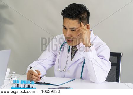 Stress Tired Doctor Wear Uniform With Stethoscope Thinking Something While Sitting On Desk Have Bloo