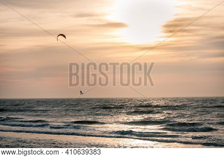 Kite Surfer In Winter At Sunset On The North Sea At The Wadden Island Of Texel