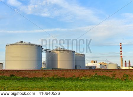 Oil Storage Tanks At Fuel Terminal On Plant. Industrial Facility For Storage Of Oil And Petrochemica