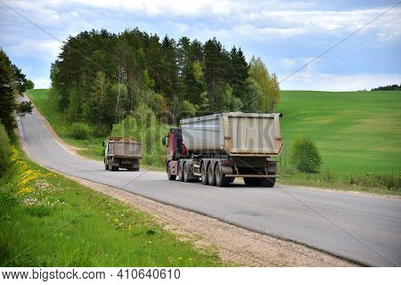 Truck With Tipper Semi Trailer Transported Sand From The Quarry On Driving Along Highway. Modern Dum
