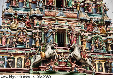 Exterior Of Colorful Majestic Facade Of Temple With Sculptures And Ornaments. Ornamental Exterior Of
