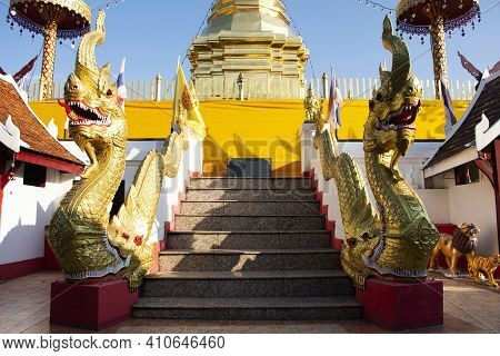 Naga Serpent And Chedi Pagoda Stupa Of Wat Phra That Doi Kham Or Temple Of The Golden Mountain For T