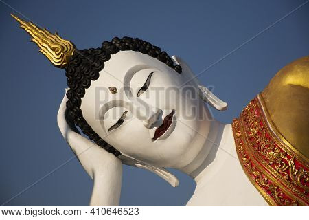 Beautiful Reclining Buddha Statue Of Wat Phra That Doi Kham Or Temple Of The Golden Mountain For Tha