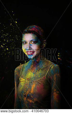 Portrait Of Beauty Model With Holi Colorful Powder Art Make On Black Studio Background.