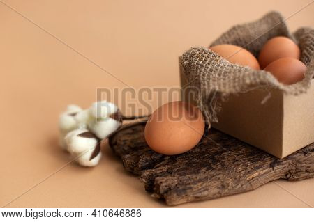 Easter Eggs In Sustainable Box With Natural Canva Burlap Cloth And Cotton Flowers