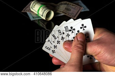 Crossed Fingers Bring Good Luck. Poker Cards With A Straight Flush Combination. Closeup Of Gambler H