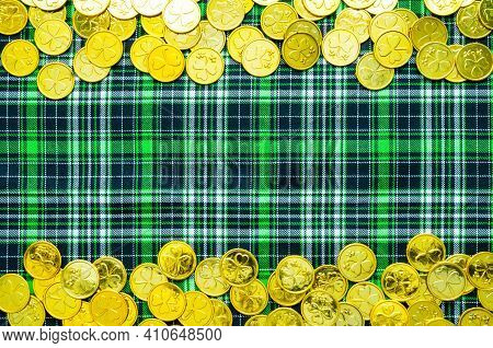 St Patricks Day background, golden coins on the green checkered cloth, St Patricks day concept, St Patricks day card, St Patricks day pattern, St Patricks day design, St Patricks day border, St Patricks day still life, St Patricks day composition