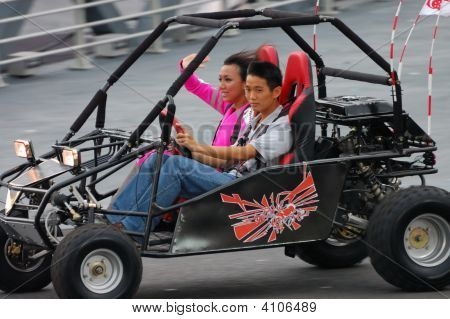 Jean Danker Waving To Audience While Riding Buggy