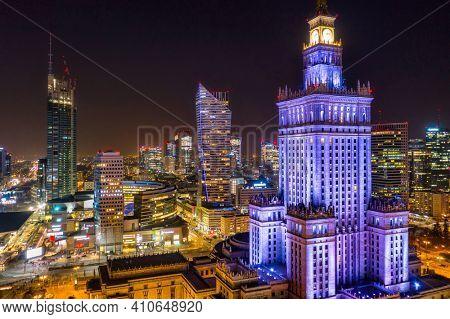 Warszawa, Poland - February 25, 2021: Beautiful architecture of Warszawa city center with the Palace of Culture and Science at night, Poland.