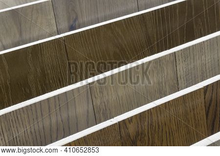 Laminate Background. Samples Of Laminate Or Parquet With A Pattern And Wood Texture For Flooring And