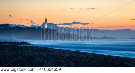 The Biarritz lighthouse at sunset,Atlantic ocean and beach in the foreground, in France
