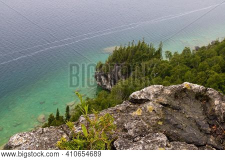 Bruce Peninsula: A Cliff And Lake With Trees In The Background