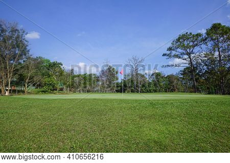 Background Of Evening Golf Course Has Sunlight Shining Down At Golf Course . Nice Scenery On A Golf