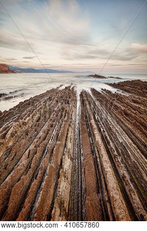 Flysch Formations In The Geological Park At Itzurun Beach, Zumaia, Basque Country, Spain.