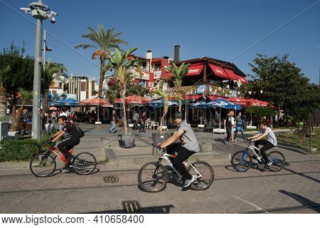 20.10.2019 - Antalya, Turkey. People On Bicycles In The City Of Turkey. Beautiful Urban Landscape Vi