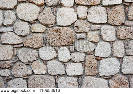 Blocks Of An Ancient Castle Surface. Rough Weathered Ancient Stone Wall Surface Texture.