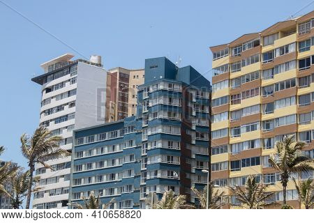 Tall Residential Apartments Against Clear Blue Sky