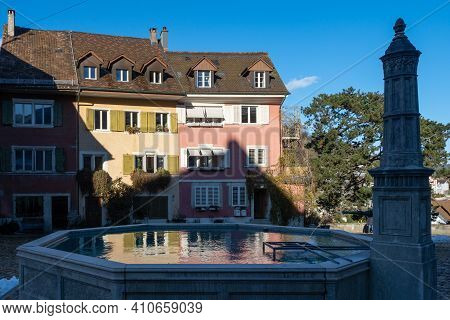 Brugg Ag, Switzerland - January 1st 2021: Historic Centre: Fountain And Houses
