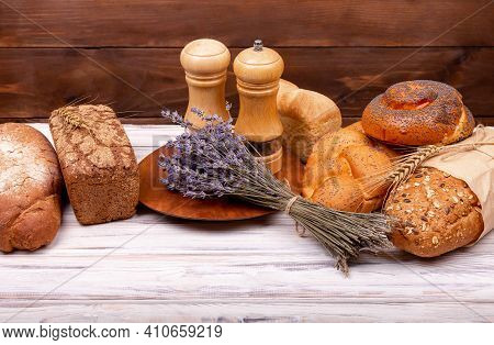 Close-up On Traditional Bread. Freshly Baked Traditional Bread. Rural Breakfast With Fresh Bread. Fr