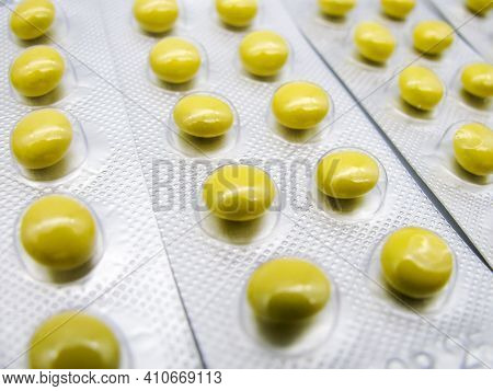 Small round yellow tablets validol, which are used in cardiology, neuroses, angina, sea and air sick