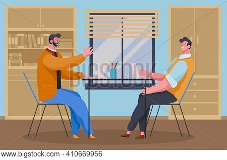 Businessmen Dressed In Casual Clothes Are Sitting At The Table With Laptops And Talking. Office Work