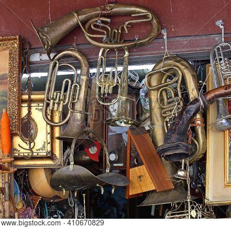 Damaged Beaten Brass Musical Instruments At Antique Market