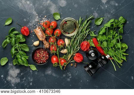 Food Cooking Background. Fresh Rosemary, Cilantro, Basil, Cherry Tomatoes, Peppers And Olive Oil, Sp