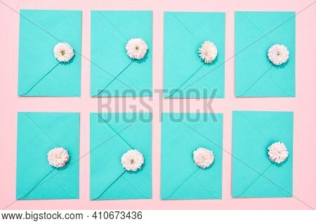 Envelope With A Flower Lying On A Pink Background. Lilac Envelope Lying As A Gift For The Day Of Mar