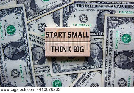 Start Small Think Big Symbol. Concept Words 'start Small Think Big' On Wooden Blocks On A Beautiful