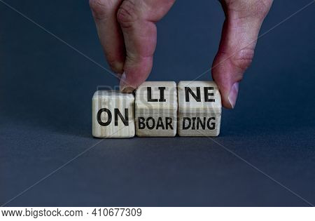 Online Onboarding Symbol. Businessman Turns Wooden Cubes With Words 'online Onboarding'. Beautiful Y