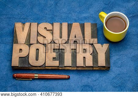 visual poetry word abstract in vintage letterpress wood type with a cup of coffee against handmade bark paper, literature and visual media concept