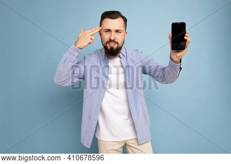 Dissatisfied Handsome Good Looking Young Brunette Unshaven Man With Beard Wearing Casual White T-shi