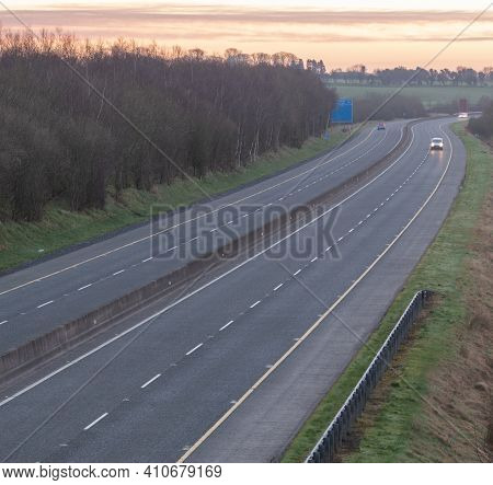 Part Of A Motorway From Dublin To Galway At Sunrise .