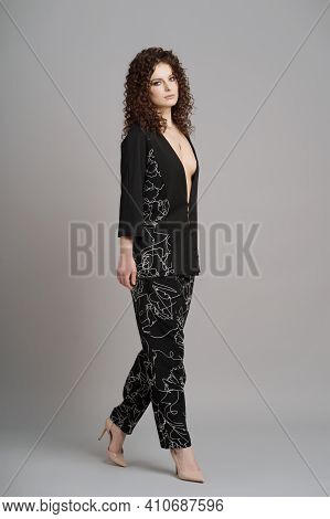 Full Length Portrait Of Cute Woman With Modern Hairdo In Stylish Clothes In Black Stylish Costume On
