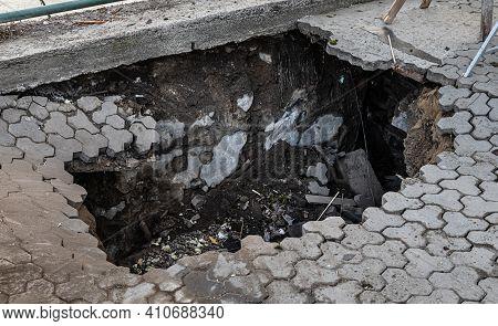 Deep Hole In Pedestrian Sidewalk Area