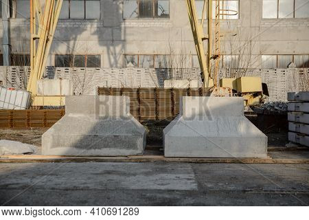 Warehouse Of The Precast Concrete Plant. Reinforced Concrete Foundations For The Installation Of Col