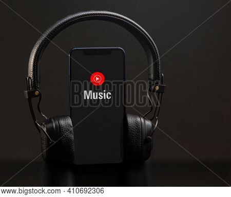 Mobile phone with Youtube Music logo on screen, Stream Songs and Videos app. Belgorod , Russia - APR, 16, 2020: