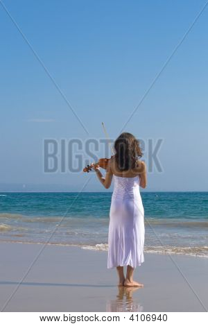 Young Happy Indian Violin Player On Beach