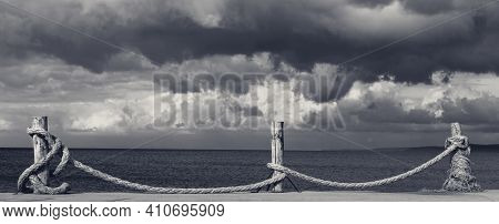 Panoramic View On Black And White Seafront, Sea And Cloudy Storm Sky. Turkey, Erdek, Coast Of Marmar