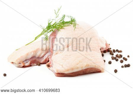 Raw duck breast fillets with dill and black pepper isolated on white background