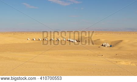 Campground Among The Sand Dunes In The Sahara Desert At Tunisia, North Africa